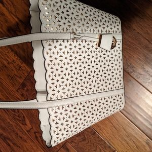 White and Told Michael Kors purse.